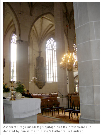 A view of Gregorius Mättig's epitaph and the brass chandelier donated by him in the St. Peter's Cathedral in Bautzen.